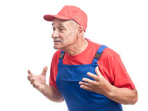 Senior mechanic arguing close-up Royalty Free Stock Photo