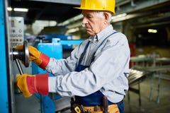 Senior Mechanic Fixing Machines at Factory Stock Photo