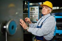 Senior Mechanic Repairing Machines Royalty Free Stock Photo