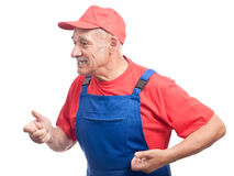 Senior mechanic simulating work Royalty Free Stock Photography