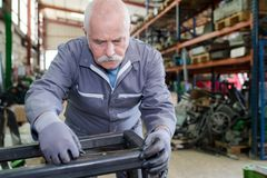 Senior mechanic working in factory Royalty Free Stock Photography