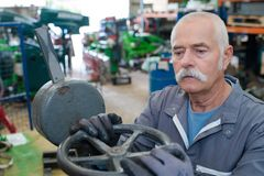 Senior mechanic works at factory Royalty Free Stock Photography