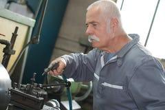 Senior mechanical inspector inspection. Man stock photography