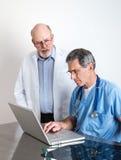 Senior Medical Doctors Discussing Patient's MRI Film Scans stock photos