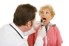 Senior Medical - Open Wide Royalty Free Stock Photos
