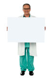 Senior medical professional displaying banner ad Stock Photos