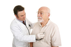 Senior Medical - Stethoscope. Doctor listening to a senior patient's heartbeat. Isolated on white royalty free stock photo
