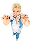 Senior doctor looking at glasses Stock Photography