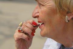 Senior medication. Close-up of a senior woman taking a vitamin pill Stock Photo