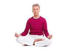 Senior meditating in tailor seat Stock Photography