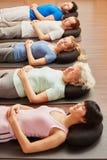 Senior meditating in yoga class Royalty Free Stock Photography