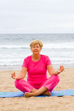 Senior meditation Stock Photo