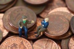 Senior men coins B. Miniature model of senior men on British coins Stock Image