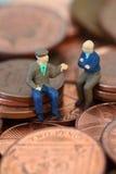 Senior men coins C. Miniature model of senior men on British coins Stock Images