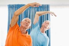 Senior men doing exercises Stock Photo