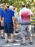 Senior Men enjoying Bocce Beachside royalty free stock photography