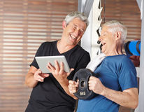 Senior men exercising in gym Stock Photography