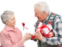Senior men give gifts  senior women Stock Photos