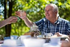 Senior men having breakfast in garden Royalty Free Stock Photo