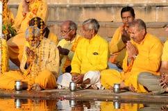Senior men perform ritual ceremony at Pushkar Sarovar lake,India royalty free stock images