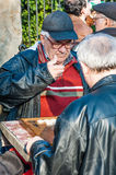 Senior men playing backgammon Royalty Free Stock Photography
