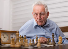 Senior men playing chess Stock Photos