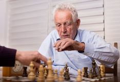 Senior men playing chess Royalty Free Stock Photography