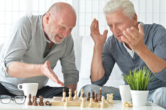 Senior men  playing chess Royalty Free Stock Photo