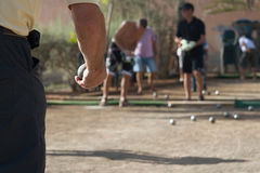 Senior men playing petanque. Balls on the ground stock photography