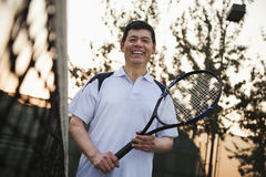 Senior men playing tennis, portrait Stock Image