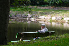 Senior men sitting on a bench Stock Images