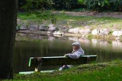 Senior men sitting on a bench stock images