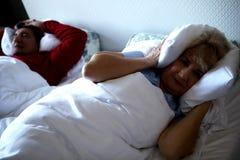Old man snoring Stock Image