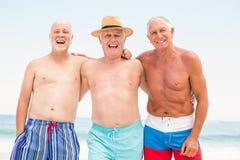 Senior men standing at the beach Stock Image