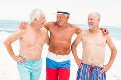 Senior men standing at the beach Stock Photos