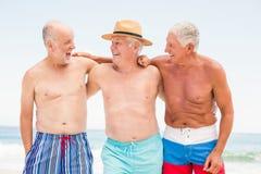 Senior men standing at the beach Stock Images