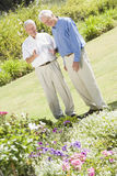 Senior men standing in garden Royalty Free Stock Images