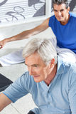 Senior men stretching in fitness. Center before exercising royalty free stock photos