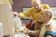 Senior men using computer Royalty Free Stock Photography