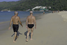 Senior men walking on the beach Royalty Free Stock Images