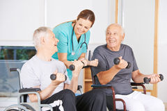 Senior men in wheelchairs lifting dumbbells Royalty Free Stock Images