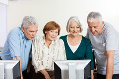 Senior Men And Women Using Computer In Classroom Stock Photography