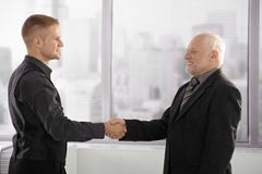 Senior and mid-adult businessman shaking hands Stock Photography