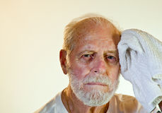 Senior Model Mopping His Brow Stock Photos