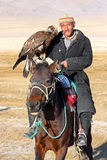 The senior Mongolian horseman with eagle Royalty Free Stock Photos