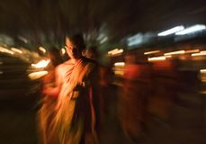 Senior Monk carrying lamp and walking while doing prayers at Yi Peng festival, Chiang Mai, Thailand