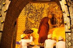 The senior monk wash Mahamuni Buddha image stock photos
