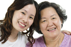 Senior mother and adult daughter close up face Stock Images