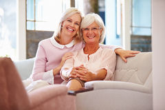 Senior Mother With Adult Daughter Relaxing On Sofa Royalty Free Stock Photo