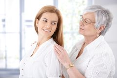 Senior mother and adult daughter smiling Royalty Free Stock Images